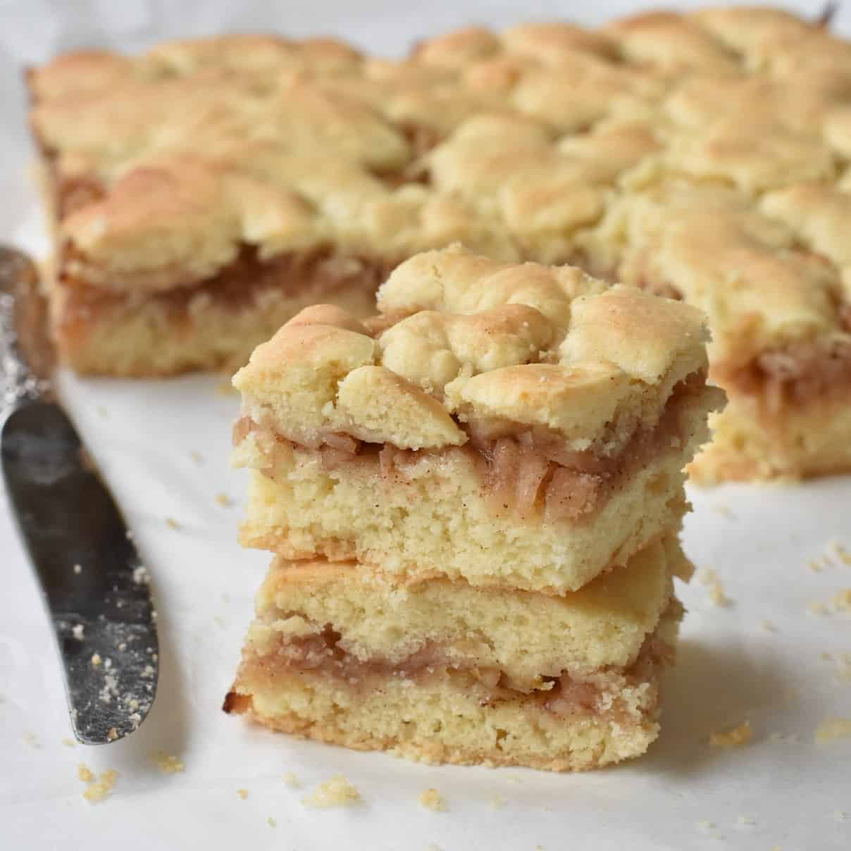 Apple Slice squares stacked in a pile.
