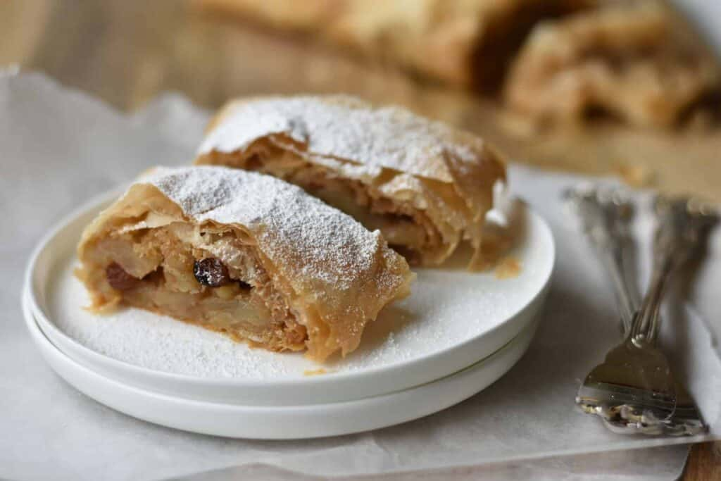 Slices of apple strudel dusted in icing sugar.