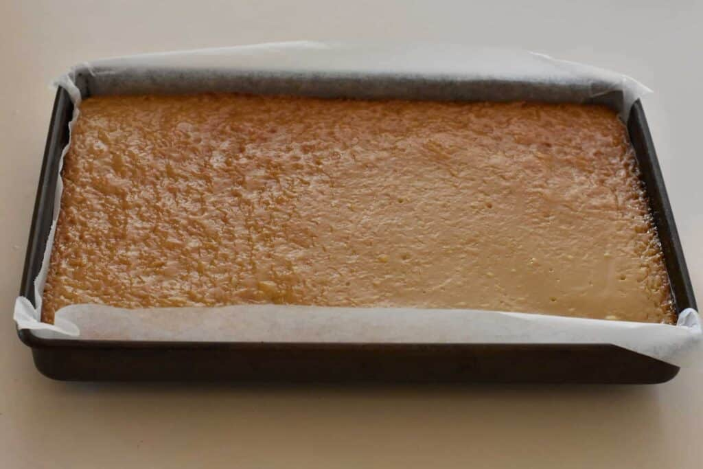 Cooked caramel layer of the slice.