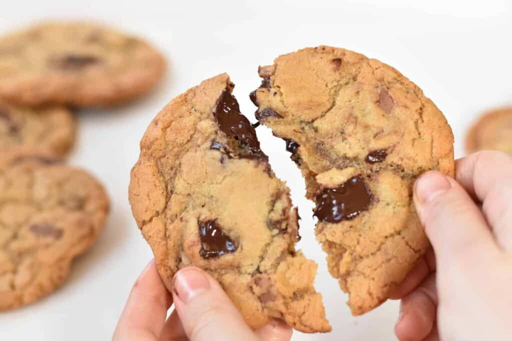Chocolate chunk cookie broken in half.