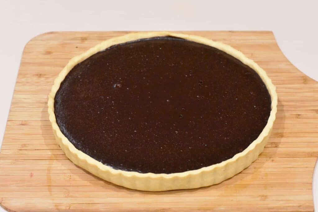 Cooked chocolate layer of tart.