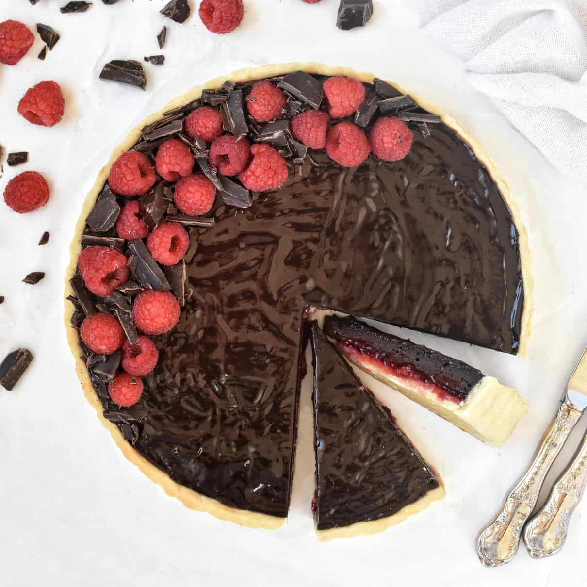 Chocolate Raspberry Tart with A Mirror Glaze sliced view from above.
