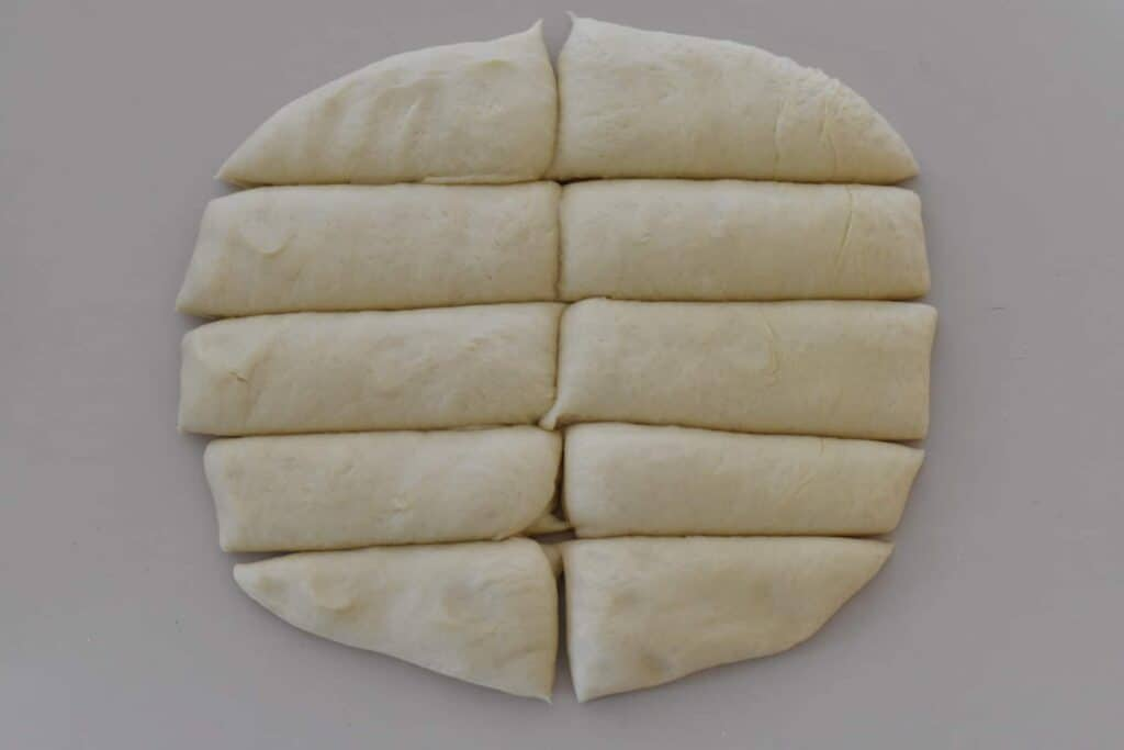 Dough in shape of rectangle divided into 10 pieces.