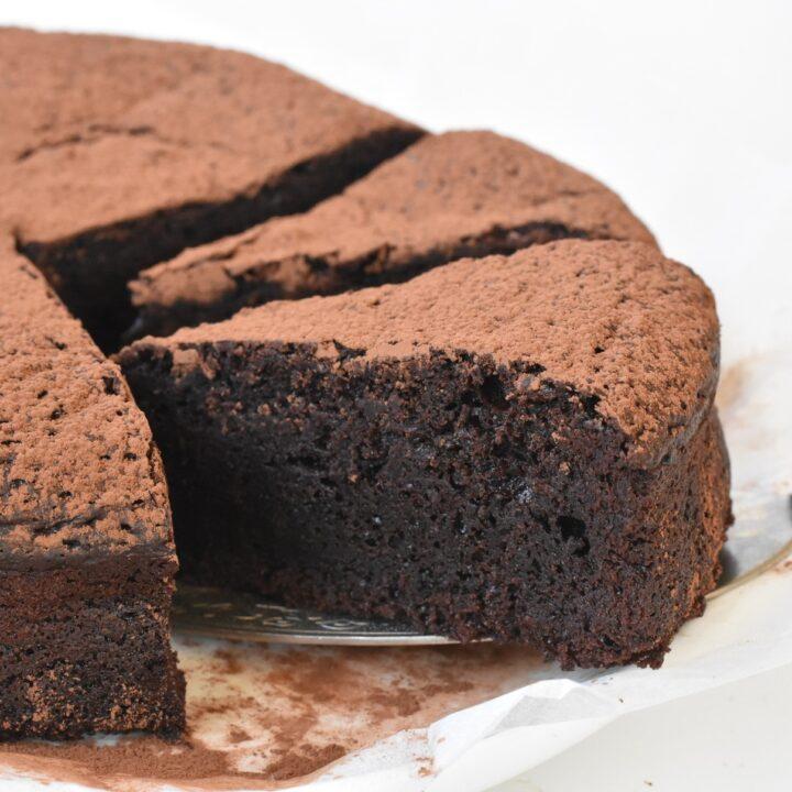 Flourless Chocolate Cake slices on display.