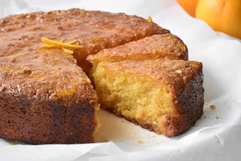 Slices of flourless orange cake on serving plate.