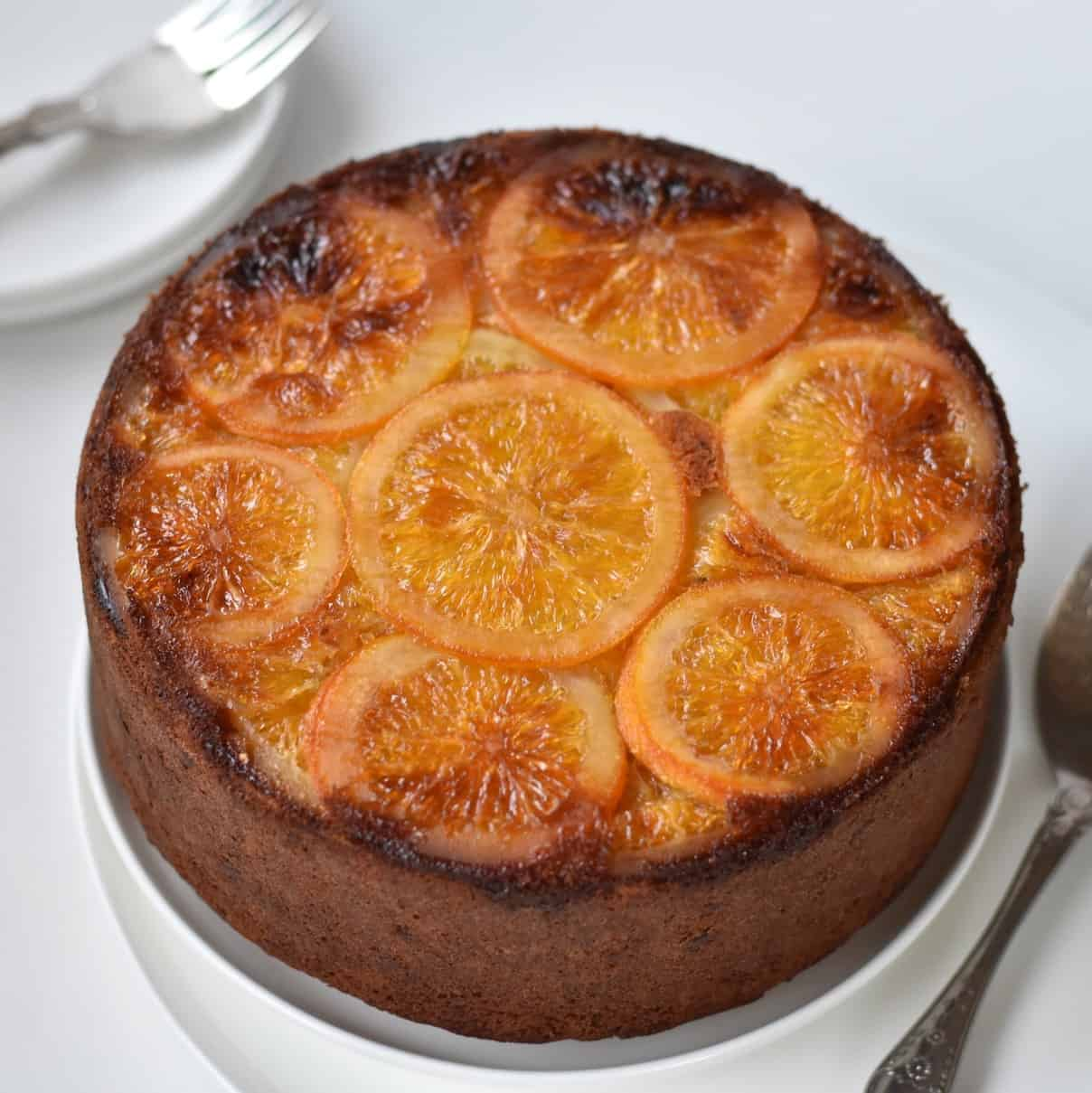 Hazelnut Cake with Candied Oranges displayed on a plate.