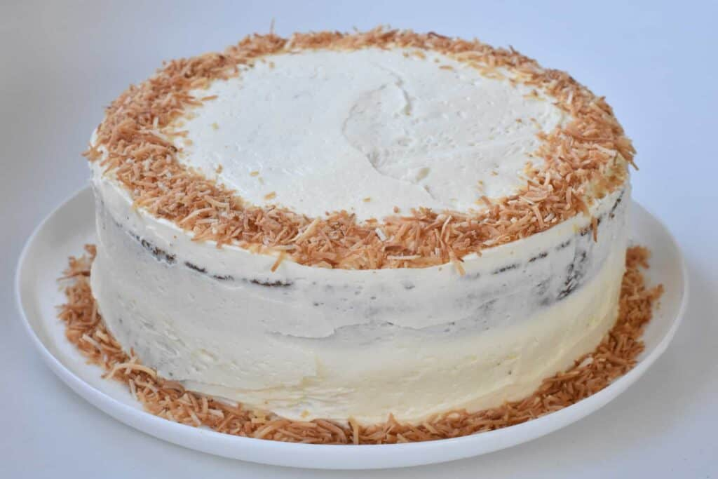 .Finished hummingbird cake topped with ring of toasted coconut.