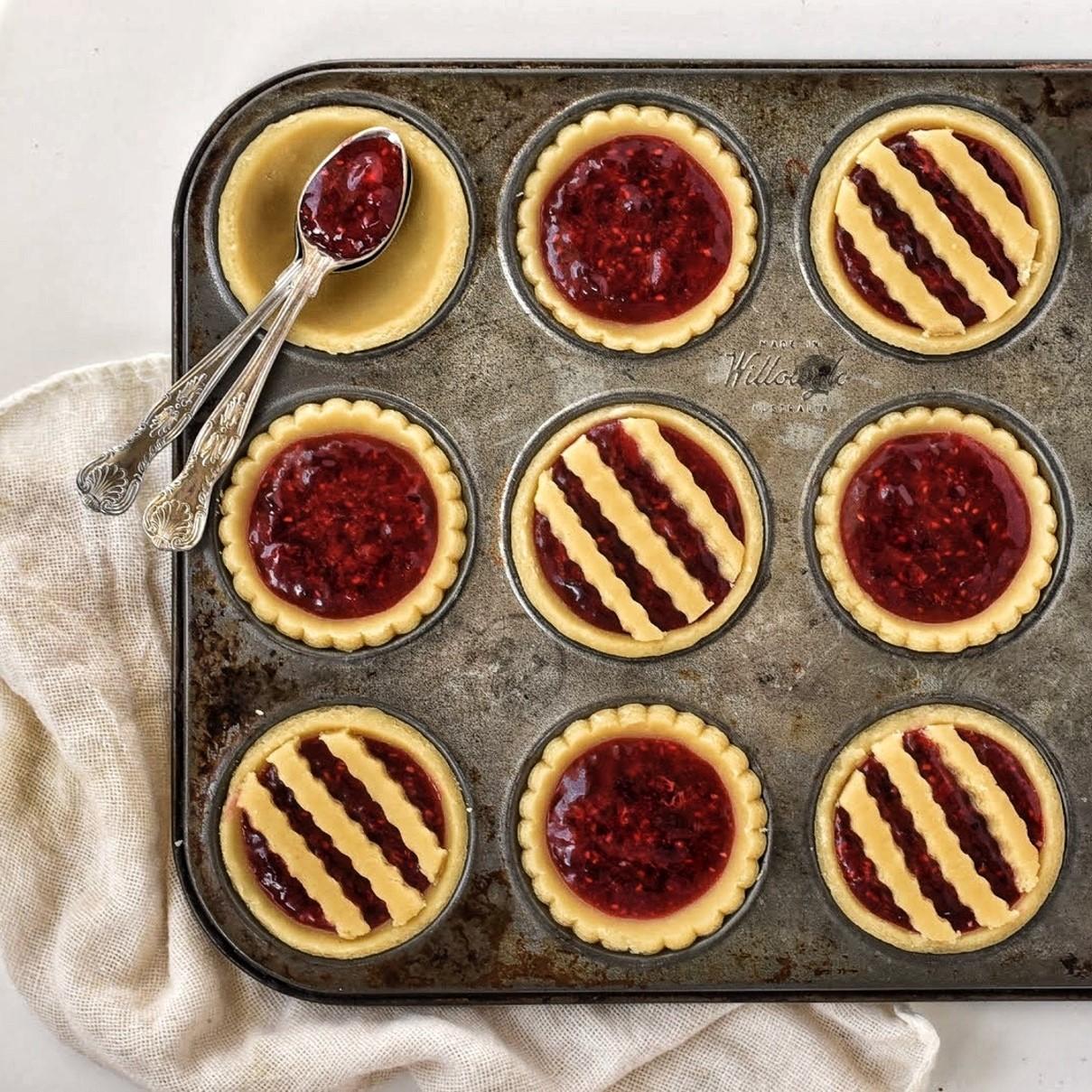Jam Tarts in tins before baking.