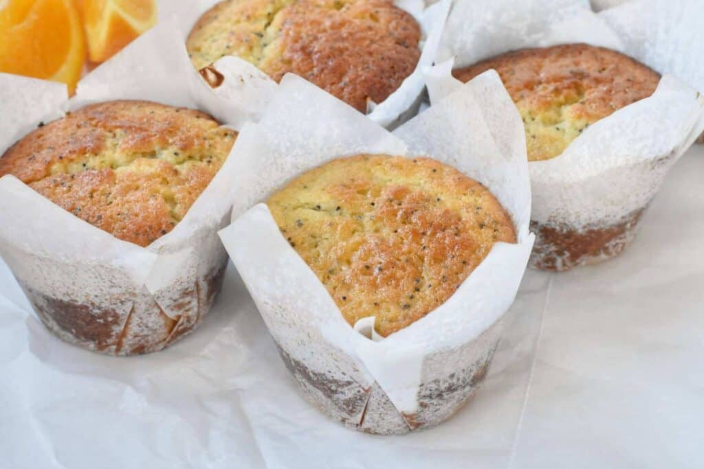 Baked Orange Poppyseed Muffins in paper cases.