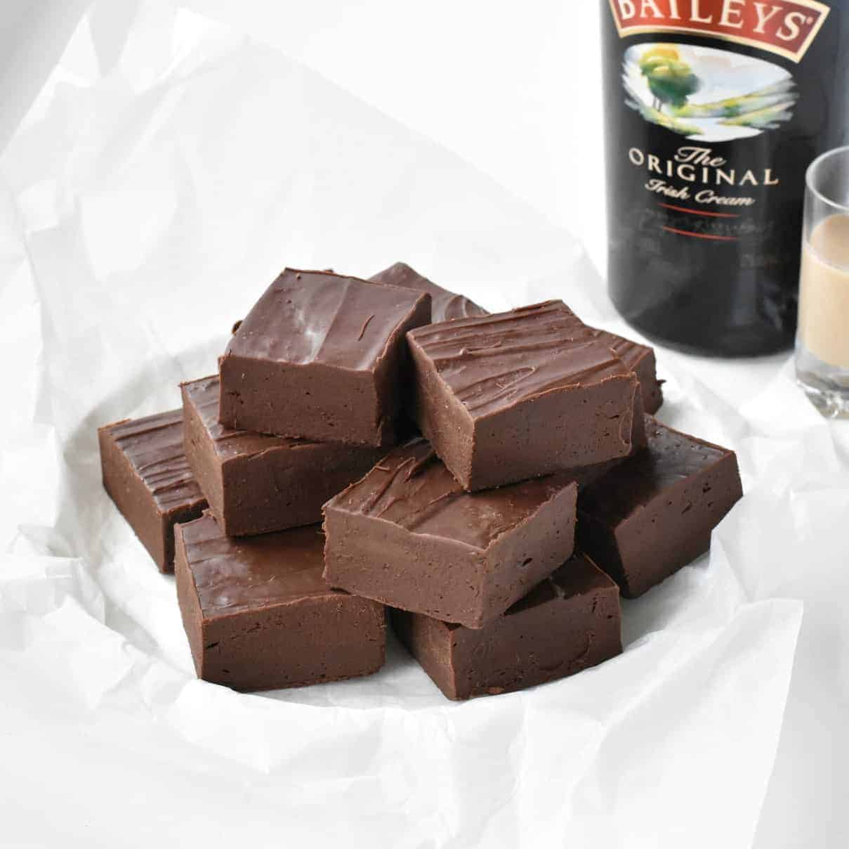 Squares of Baileys Fudge on a plate.