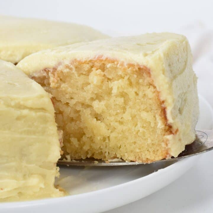Slice of Vanilla Cake with Buttercream on cake server.
