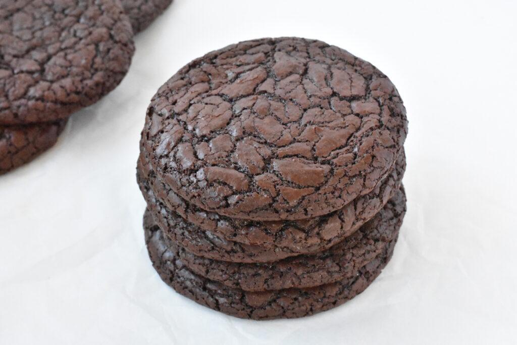 Stack of cooked fudgy brownie cookies.