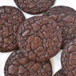 Fudgy brownie cookies on baking paper.