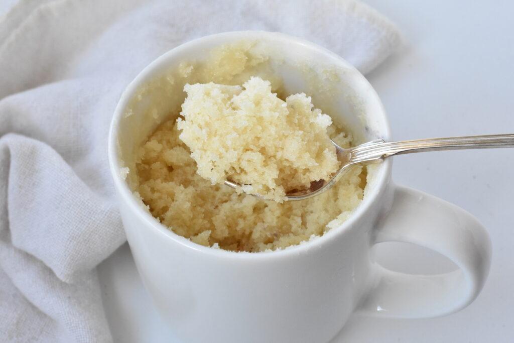 Spoonful of vanilla mug cake.