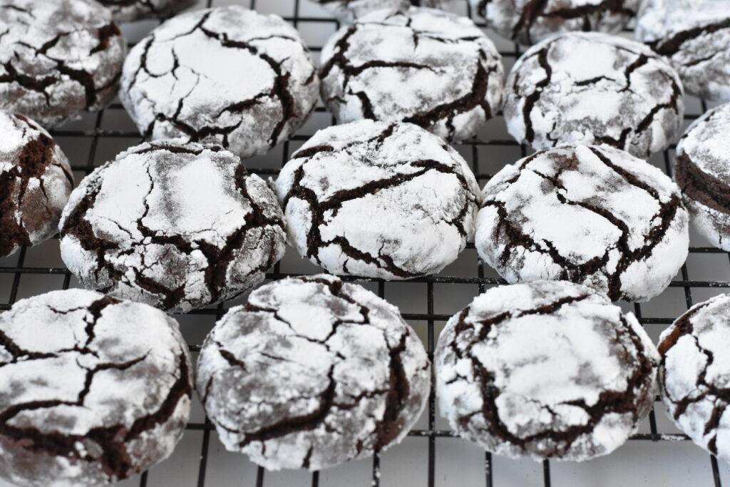 Chocolate crinkle cookies on cooling rack.
