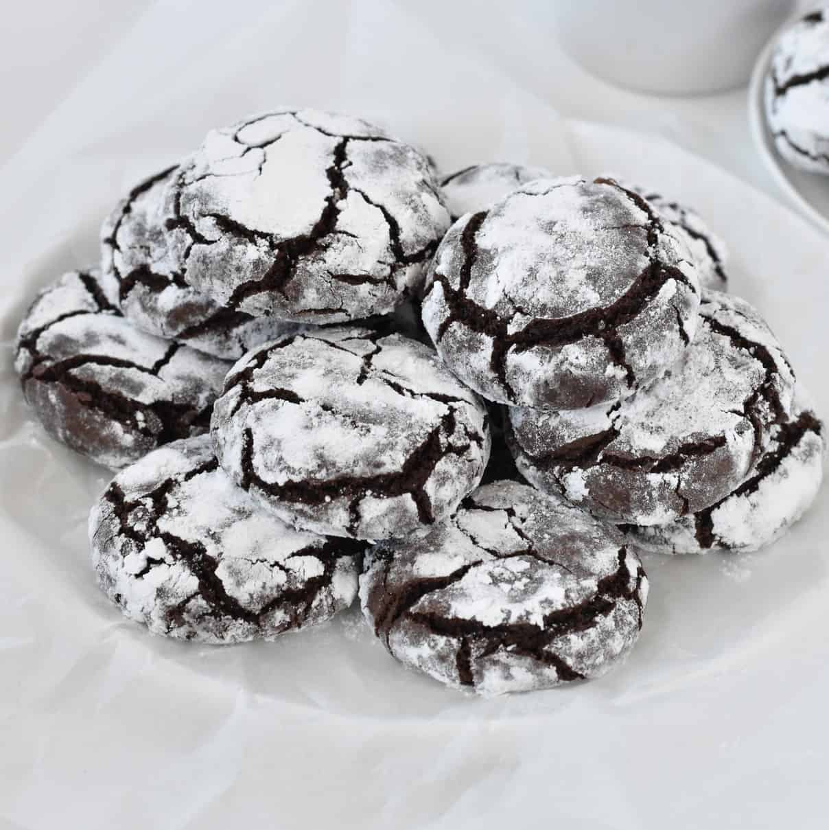 Chocolate crinkle cookies stacked in a pile.