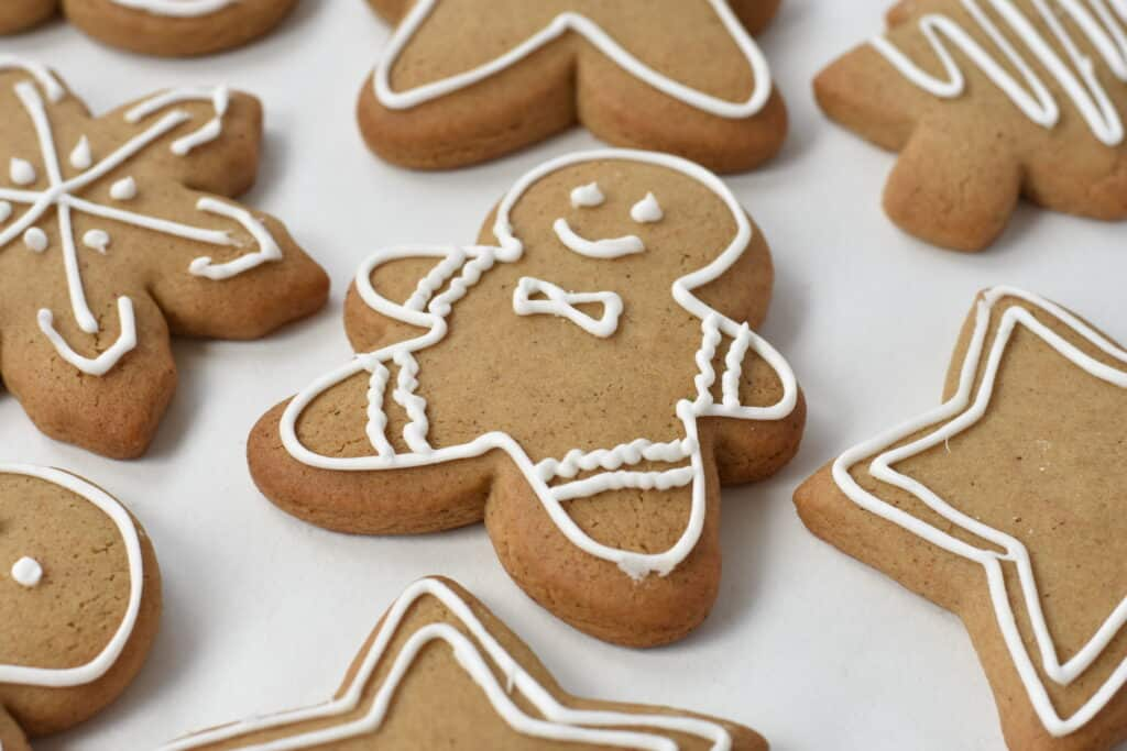 Decorated Gingerbread Cookies on Baking Paper
