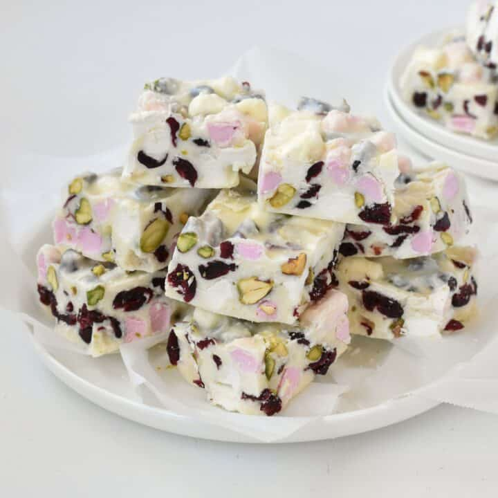 Squares of White Christmas Rocky Road on a plate.